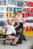 Salesman Assisting Customer In Hardware Store — Stock Photo