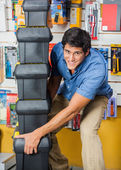 Man Carrying Stacked Toolboxes In Hardware Store — Stock Photo