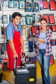 Customer And Salesman With Tool Cases In Store — Stockfoto