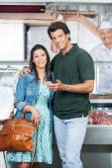 Loving Couple In Butchery — Stock Photo