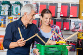Worker Showing Folding Ruler To Customer In Hardware Shop — Stock Photo