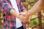 Construction Workers Shaking Hands At Site — Stock Photo