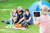 Grandmother Photographing Family At Campsite — Stock Photo