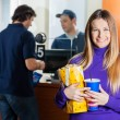 Woman Holding Snacks While Man Buying Tickets At Box Office — Stock Photo #64040759