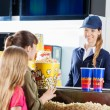 Girls Buying Snacks From Female Seller At Concession Stand — Stock Photo #64041127