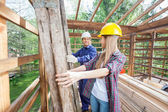 Smiling Construction Worker Working With Colleague At Site — Stock Photo