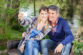 Happy Couple Taking Selfportrait At Campsite — Stock Photo