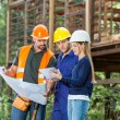 Architects Using Digital Tablet At Construction Site — Stock Photo #64122957