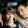 Man Looking At Woman Crying While Watching Movie — Stock Photo #64123405