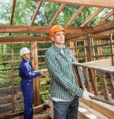 Construction Workers Working In Timber Cabin At Site — Stock Photo