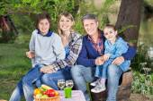 Family Sitting On Chairs At Campsite — Stock Photo