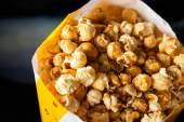 Roasted Popcorns In Paperbag At Cinema Theater — Stock Photo