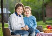 Happy Siblings With Smartphone At Campsite — Stock Photo