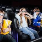 Scared Children Watching 3D Movie In Cinema Theater — Stock Photo #64138143