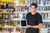 Man Displaying Digital Tablet In Hardware Store — Stock Photo