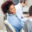 Smiling Female Customer Service Representative In Office — Stock Photo #64298403