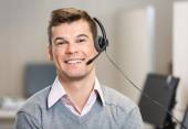 Customer Service Representative Wearing Headset While Smiling In — Stock Photo