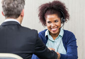 Happy Female Customer Service Agent Shaking Hands With Manager — Stock Photo