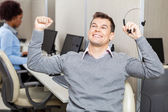 Male Customer Service Representative With Arms Raised Holding He — Stock Photo