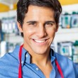Confident Male Worker Smiling In Hardware Shop — Stock Photo #64659493