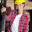 Female Engineer Wearing Hardhat In Workshop — Stock Photo #64659595