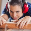 Concentrated Carpenter Cutting Wood With Tablesaw — Stock Photo #64659607