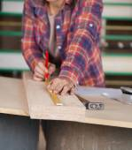 Midsection Of Carpenter Measuring Wood — Stock Photo