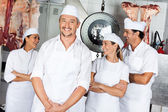 Male Butcher With Team In Butchery — Stock Photo