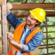 Construction Worker Measuring Timber Frame — Stock Photo #70269145