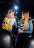Mother Consoling Scared Daughter In Cinema Theater — Stock Photo