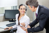 Manager And Customer Service Representative Discussing In Office — Stock Photo