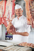 Confident Butcher Holding Raw Meat — Stock Photo