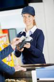Smiling Worker Accepting Payment Through NFC Technology At Cinem — Stock Photo