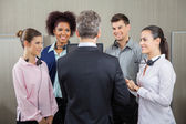 Manager Discussing With Employees — Stock Photo