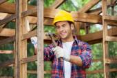 Worker Hammering Nail On Wooden Cabin — Stock Photo