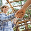 Smiling Architect Greeting Colleague At Construction Site — Stock Photo #70960819
