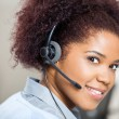 Confident Female Customer Service Agent Wearing Headset At Desk — Stock Photo #70962323