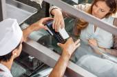 Customer Paying Through Smartphone At Butchery — Stock Photo