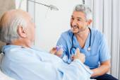 Happy Caretaker Discussing Prescription With Senior Man — Stock Photo
