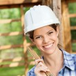 Beautiful Architect Holding Measuring Tape At Site — Stock Photo #71728689