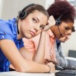 Tired Customer Service Representative In Office — Stock Photo #71729659