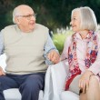 Senior Couple Holding Hands And Looking At Each Other — Stock Photo #71729947