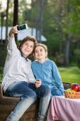 Siblings Taking Selfportrait At Campsite — Stock Photo
