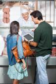 Couple With Digital Tablet At Butchery — Stock Photo