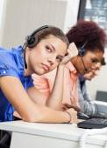 Tired Customer Service Representative In Office — Stock Photo