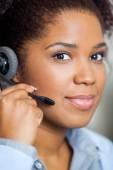 Portrait Of Young Female Customer Service Representative Wearing — Stock Photo