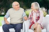 Senior Couple Holding Hands And Looking At Each Other — Stock Photo