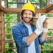Happy Worker Carrying Wooden Planks On Shoulder — Stock Photo #72037629