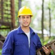 Confident Worker Carrying Ladder At Construction Site — Stock Photo #72038553