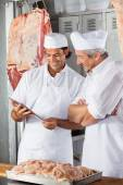 Butchers Looking At Tablet Computer In Butchery — Stock Photo